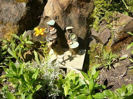 clay figures in the garden