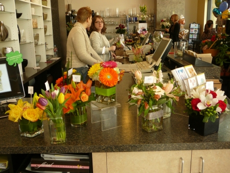 a counter full of posies